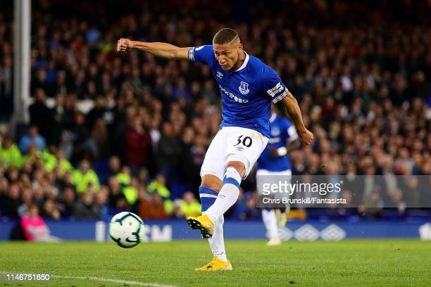 Richarlison of Everton scores the opening goal during the Premier League match between Everton FC and Burnley FC at Goodison Park on May 03 2019 in...