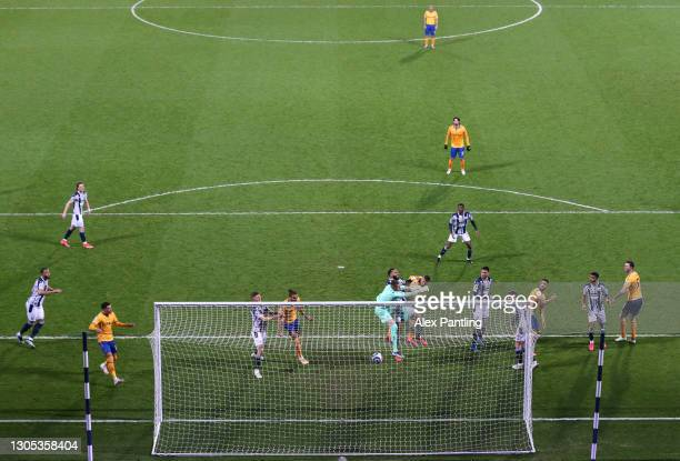 Richarlison of Everton scores their side's first goal past Sam Johnstone of West Bromwich Albion during the Premier League match between West...