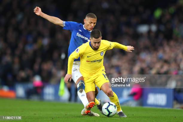 Richarlison of Everton tackles Eden Hazard of Chelsea during the Premier League match between Everton FC and Chelsea FC at Goodison Park on March 17...