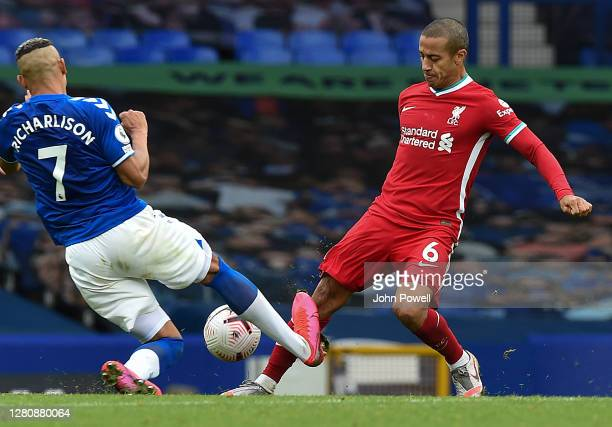 Richarlison of Everton takes out Thiago Alcantara of Liverpool with a tackle that gets him the red card during the Premier League match between...