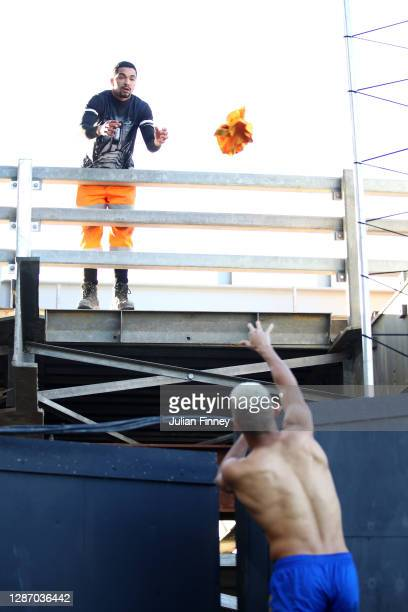 Richarlison of Everton throws his shirt to a builder in the stand following the Premier League match between Fulham and Everton at Craven Cottage on...