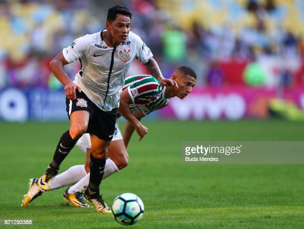Richarlison of Fluminense struggles for the ball with Giovanni Augusto of Corinthians during a match between Fluminense and Corinthians as part of...
