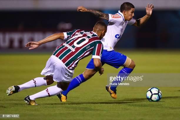 Richarlison of Fluminense struggles for the ball with Lucas Romero of Cruzeiro during a match between Fluminense and Cruzeiro as part of Brasileirao...