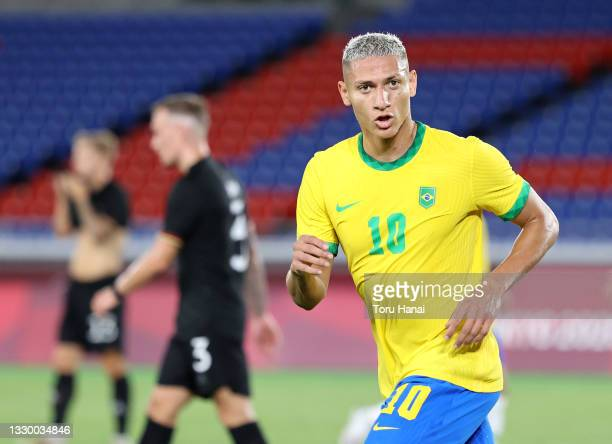 Richarlison of Team Brazil celebrates after scoring their side's second goal during the Men's First Round Group D match between Brazil and Germany...