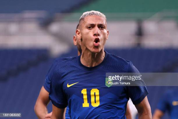 Richarlison of Team Brazil celebrates after scoring their side's second goal during the Men's First Round Group D match between Saudi Arabia and...