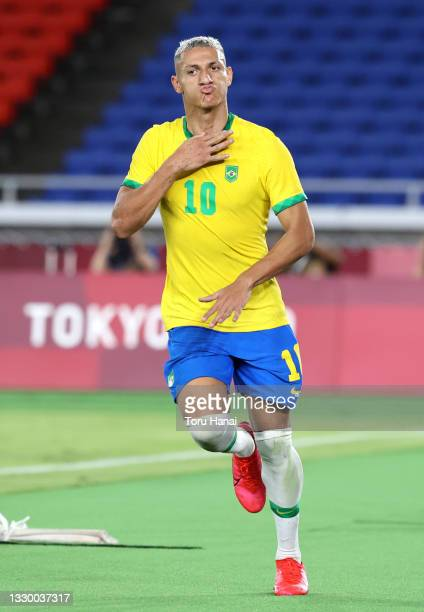 Richarlison of Team Brazil celebrates after scoring their side's third goal during the Men's First Round Group D match between Brazil and Germany...