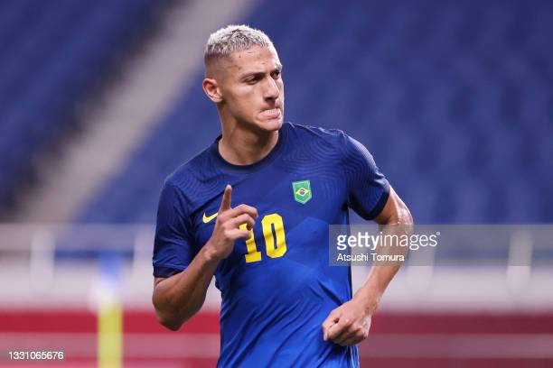 Richarlison of Team Brazil celebrates after scoring their side's third goal during the Men's First Round Group D match between Saudi Arabia and...