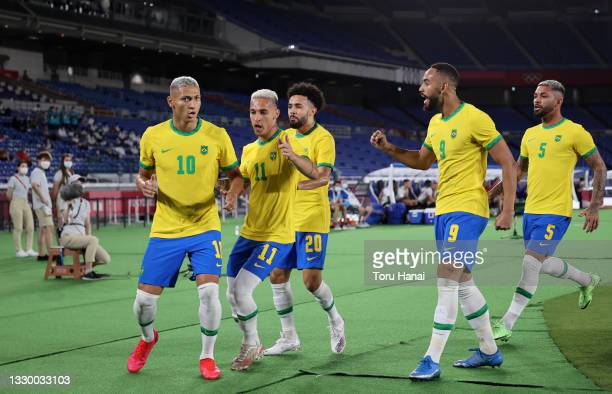Richarlison of Team Brazil celebrates with Antony and team mates after scoring their side's first goal during the Men's First Round Group D match...