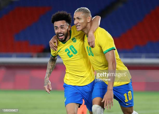 Richarlison of Team Brazil celebrates with Claudinho after scoring their side's third goal during the Men's First Round Group D match between Brazil...