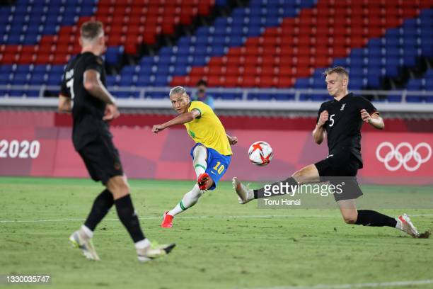 Richarlison of Team Brazil scores their side's third goal during the Men's First Round Group D match between Brazil and Germany during the Tokyo 2020...