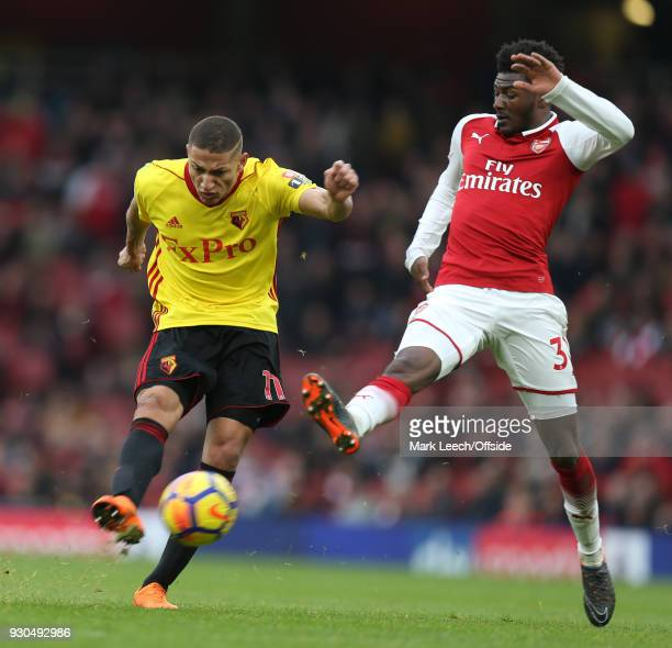 Richarlison of Watford and Ainsley MaitlandNiles of Arsenal during the Premier League match between Arsenal and Watford at Emirates Stadium on March...