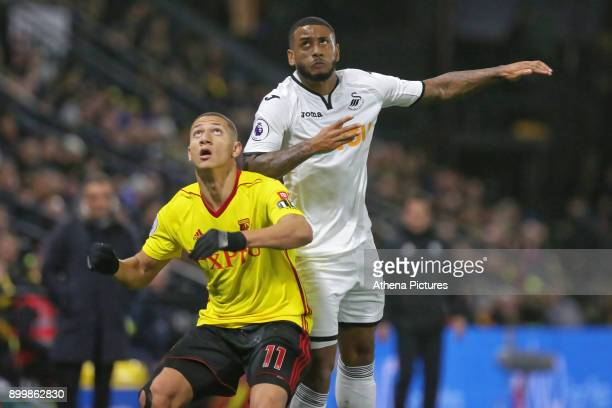 Richarlison of Watford and Luciano Narsingh of Swansea City wait for the ball during the Premier League match between Watford and Swansea City at the...