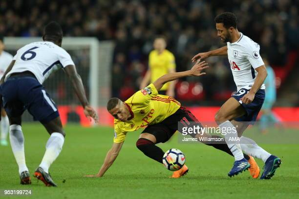 Richarlison of Watford and Mousa Dembele of Tottenham during the Premier League match between Tottenham Hotspur and Watford at Wembley Stadium on...