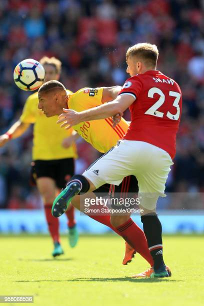 Richarlison of Watford battles with Luke Shaw of Man Utd during the Premier League match between Manchester United and Watford at Old Trafford on May...