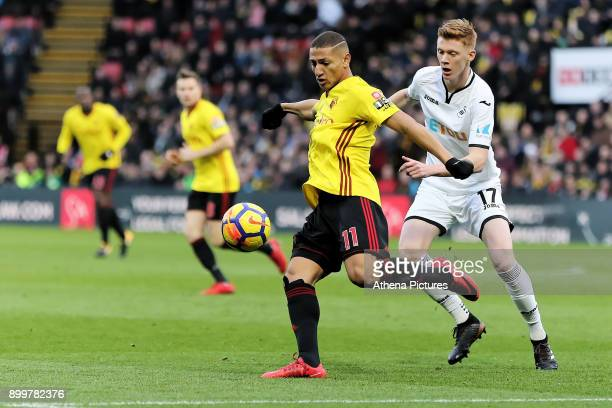 Richarlison of Watford challenged by Sam Clucas of Swansea City during the Premier League match between Watford and Swansea City at the Vicarage Road...