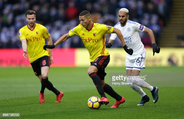 Richarlison of Watford goes past Riyad Mahrez of Leicester City during the Premier League match between Watford and Leicester City at Vicarage Road...