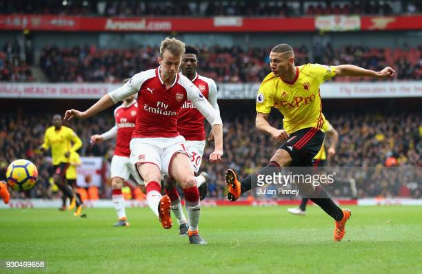 Richarlison of Watford has a shot on goal during the Premier League match between Arsenal and Watford at Emirates Stadium on March 11 2018 in London...