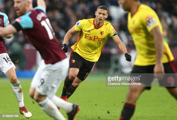 Richarlison of Watford looks past players as his shot misses during the Premier League match between West Ham United and Watford at London Stadium on...