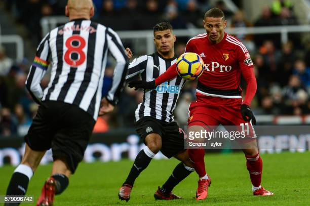 Richarlison of Watford looks to control the ball whilst being challenged by DeAndre Yedlin of Newcastle during the Premier League match between...