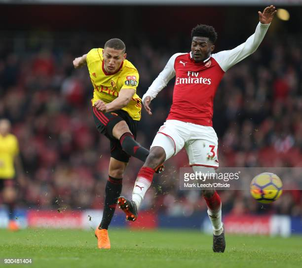 Richarlison of Watford shoots as Ainsley MaitlandNiles of Arsenal challenges during the Premier League match between Arsenal and Watford at Emirates...