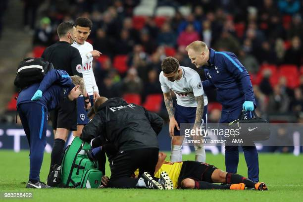 Richarlison of Watford suffers a head injury during the Premier League match between Tottenham Hotspur and Watford at Wembley Stadium on April 30...