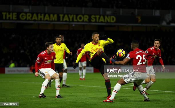 Richarlison of Watford takes on Luis Antonio Valencia of Manchester United during the Premier League match between Watford and Manchester United at...