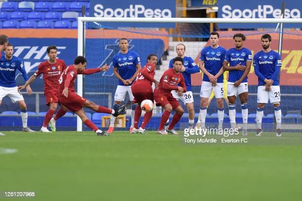 Richarlison Tom Davies Michael Keane Dominic CalvertLewin and Andre Gomes of Everton form a wall as Trent AlexanderArnold takes free kick during the...