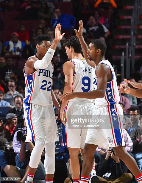 Richaun Holmes and Hollis Thompson of the Philadelphia 76ers give each other high fives against the Washington Wizards during a game at the Wells...