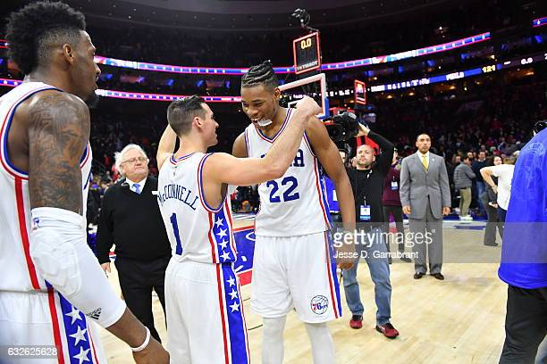 Richaun Holmes and TJ McConnell of the Philadelphia 76ers greet each other after the win against the Los Angeles Clippers at Wells Fargo Center on...