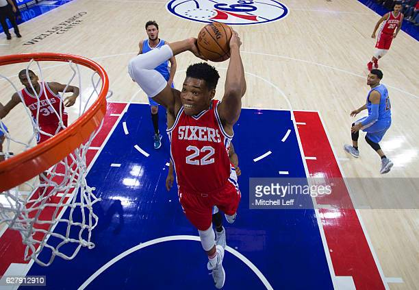 Richaun Holmes of the Philadelphia 76ers dunks the ball against the Denver Nuggets in the first quarter at Wells Fargo Center on December 5 2016 in...