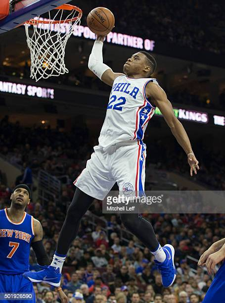 Richaun Holmes of the Philadelphia 76ers dunks the ball past Carmelo Anthony of the New York Knicks on December 18 2015 at the Wells Fargo Center in...