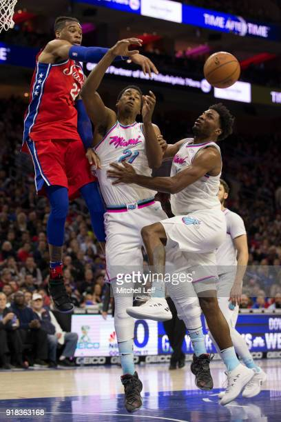 Richaun Holmes of the Philadelphia 76ers goes up for a rebound against Hassan Whiteside and Justise Winslow of the Miami Heat in the second quarter...