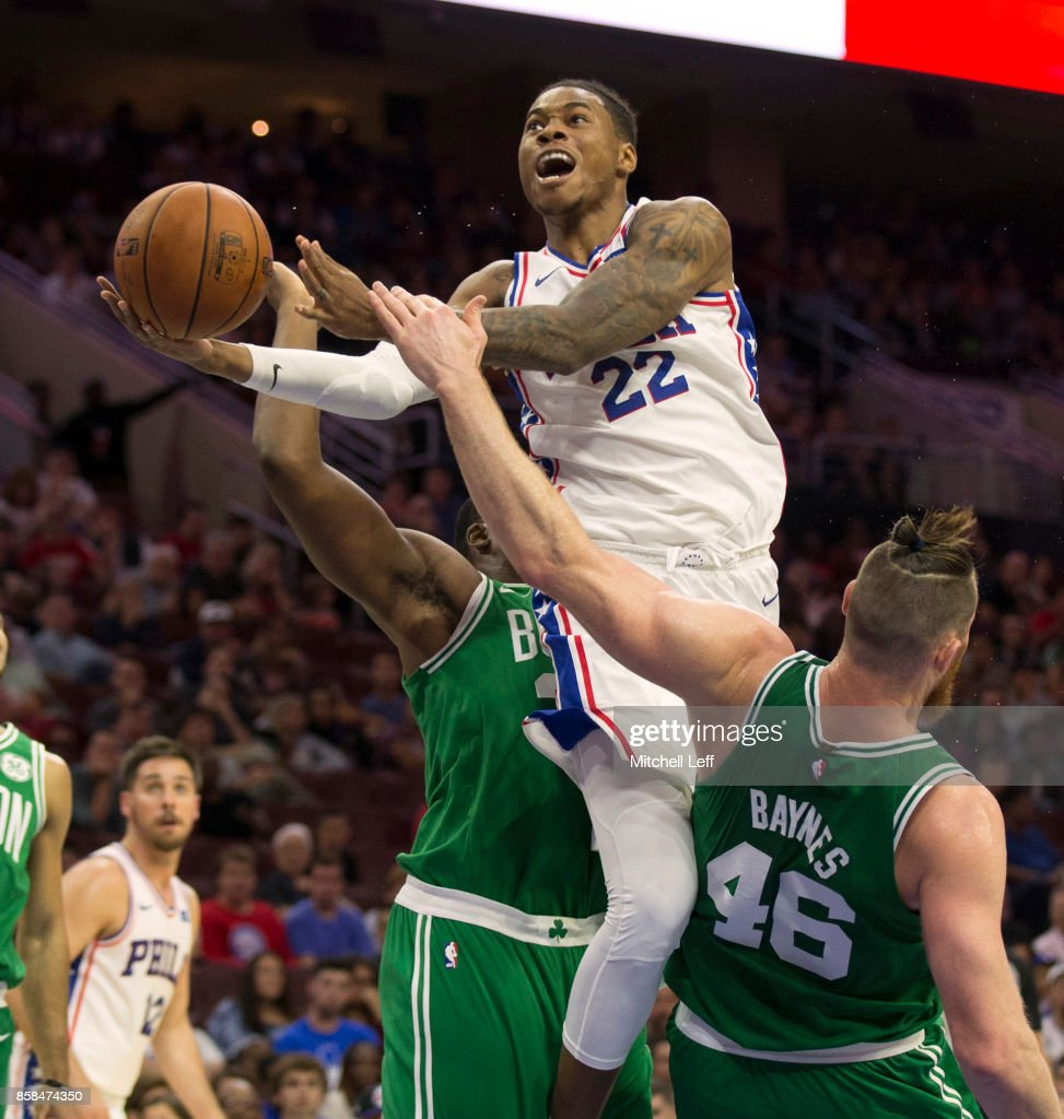 Richaun Holmes #22 of the Philadelphia 76ers goes up for a shot and is fouled by Aron Baynes #46 of the Boston Celtics in the third quarter of the preseason game at the Wells Fargo Center on October 6, 2017 in Philadelphia, Pennsylvania. The Celtics defeated the 76ers 110-102.