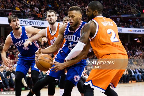Richaun Holmes of the Philadelphia 76ers tries to drive around Kyrie Irving of the Cleveland Cavaliers during the first half at Quicken Loans Arena...