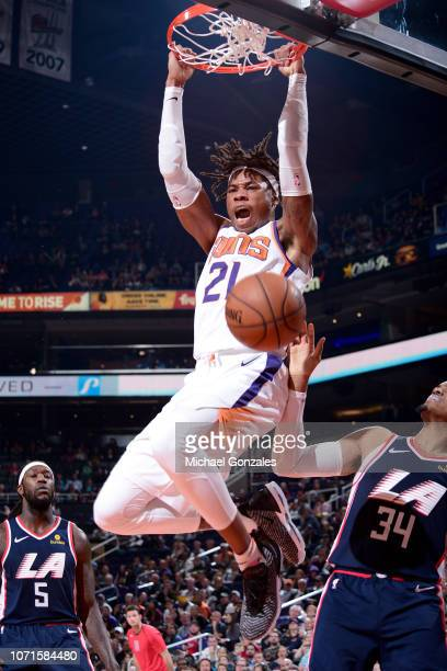 Richaun Holmes of the Phoenix Suns dunks the ball during the game against the LA Clippers on December 10 2018 at Talking Stick Resort Arena in...