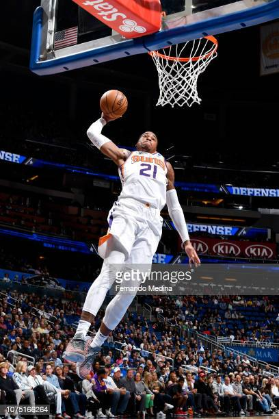 Richaun Holmes of the Phoenix Suns goes to the basket for a dunk against the Orlando Magic on December 26 2018 at Amway Center in Orlando Florida...
