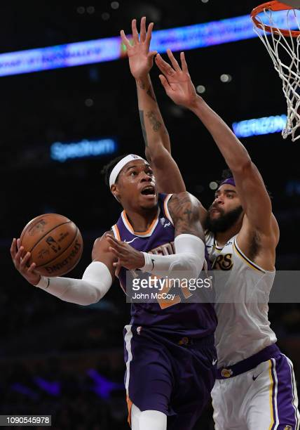 Richaun Holmes of the Phoenix Suns goes to the hoop against JaVale McGee of the Los Angeles Lakers in the first half at Staples Center on January 27...