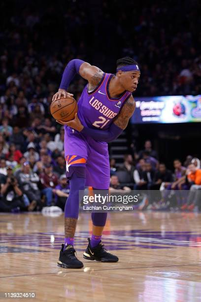 Richaun Holmes of the Phoenix Suns looks to pass the ball against the Sacramento Kings at Golden 1 Center on March 23 2019 in Sacramento California...