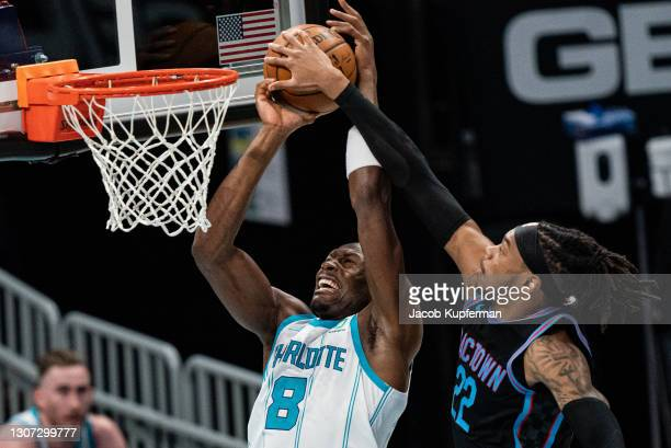 Richaun Holmes of the Sacramento Kings blocks the shot from Bismack Biyombo of the Charlotte Hornets during the first quarter at Spectrum Center on...