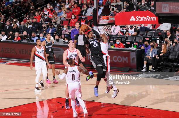 Richaun Holmes of the Sacramento Kings dunks the ball during the game against the Portland Trail Blazers on October 20, 2021 at the Moda Center Arena...