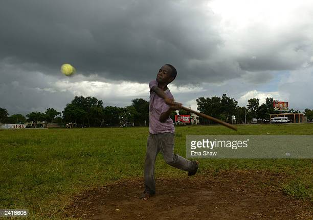 Richayo plays stickball in a field on August 18 2003 in Consuelo Dominican Republic Consuelo which has ten programs for youths to learn and play...
