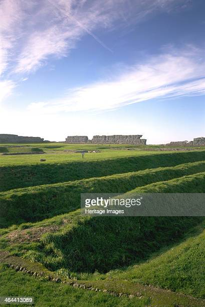 Richborough Castle, Kent, 1996. In the foreground are the triple ditches of the earth fort, with the walls of the later stone fort visible beyond. A...