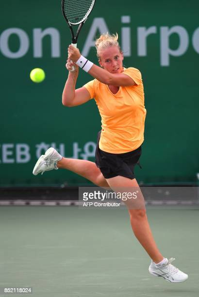 Richel Hogenkamp of the Netherlands hits a return against Beatriz Haddad Maia of Brazil during their women's singles semifinal match at the WTA Korea...