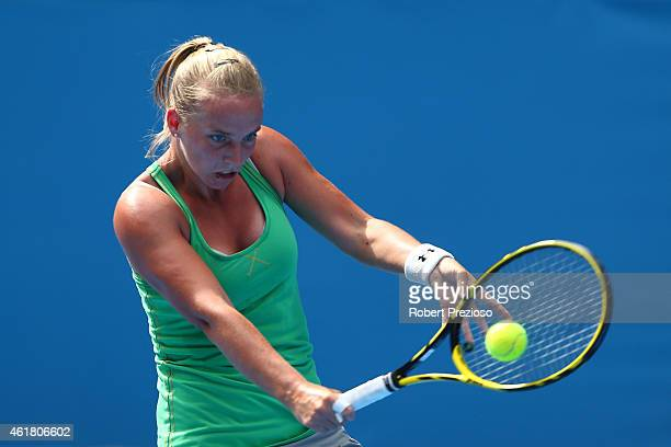 Richel Hogenkamp of the Netherlands plays a backhand in her first round match against Petra Kvitova of the Czech Republic during day two of the 2015...