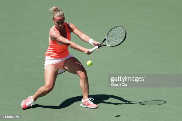 Richel Hogenkamp of the Netherlands plays a backhand in her singles match against Misaki Doi of Japan on day one of the Fed Cup World Group II...