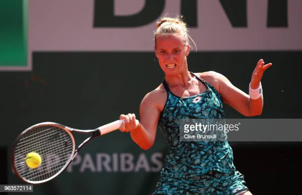 Richel Hogenkamp of the Netherlands plays a forehand during the ladies singles first round match against Maria Sharapova of Russia during day three...