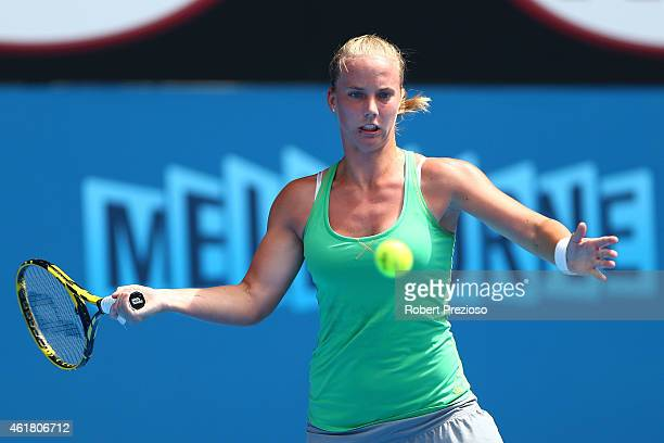 Richel Hogenkamp of the Netherlands plays a forehand in her first round match against Petra Kvitova of the Czech Republic during day two of the 2015...