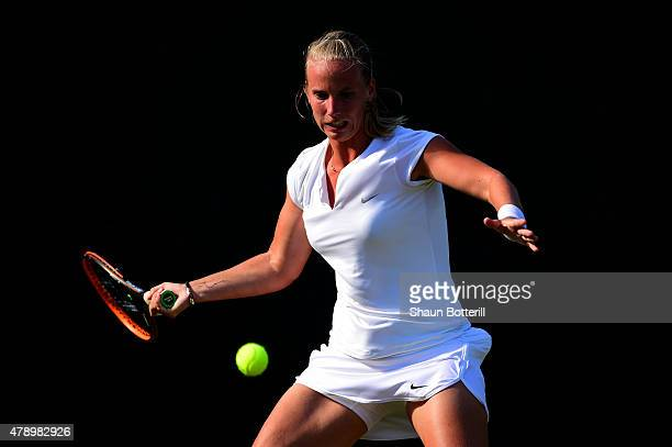 Richel Hogenkamp of the Netherlands plays a forehand in her Ladies' Singles first round match against Qiang Wang of China during day one of the...