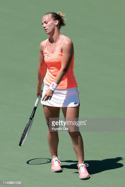 Richel Hogenkamp of the Netherlands reacts after losing a point in her singles match against Misaki Doi of Japan on day one of the Fed Cup World...