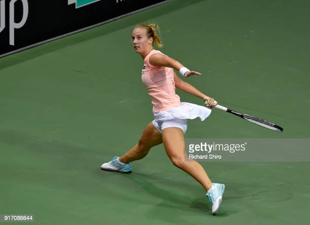 Richel Hogenkamp of the Netherlands returns a shot by Venus Williams of Team USA and during the first round of the 2018 Fed Cup at US Cellular Center...
